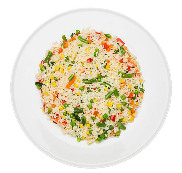 Fried rice Plate with fried rice with vegetables isolated on white fried rice stock pictures, royalty-free photos & images