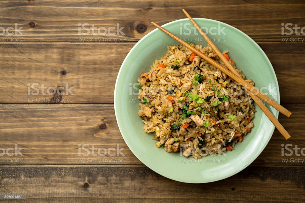 Fried Rice Top View on a Wooden Background stock photo