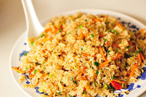 fried rice with egg and vegetables fried rice with egg and vegetables fried rice stock pictures, royalty-free photos & images