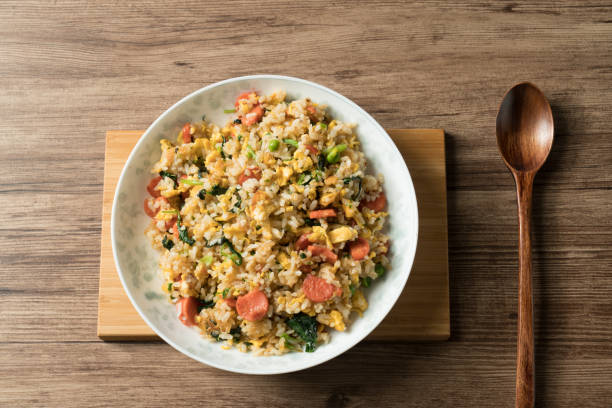 Fried rice with egg and wood grain background The homemade food. fried rice stock pictures, royalty-free photos & images