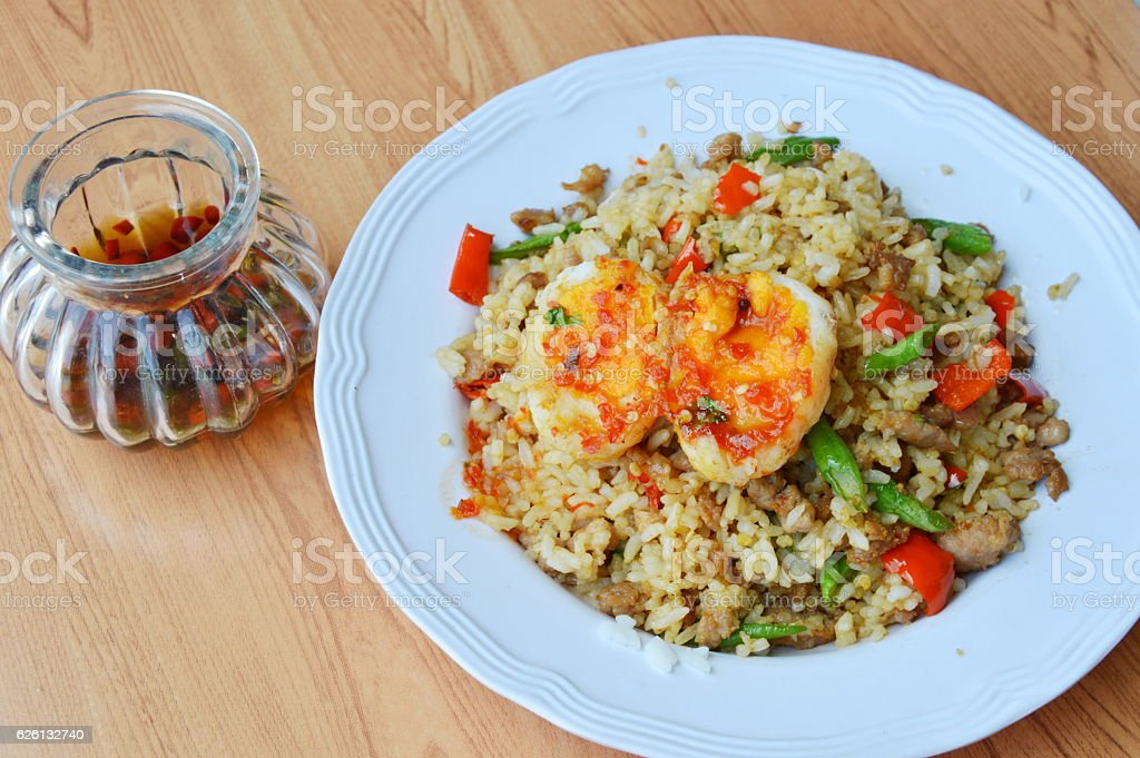 fried rice with minced pork topping egg and fish sauce stock photo