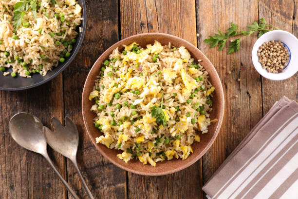 fried rice with pea and egg fried rice with pea and egg fried rice stock pictures, royalty-free photos & images