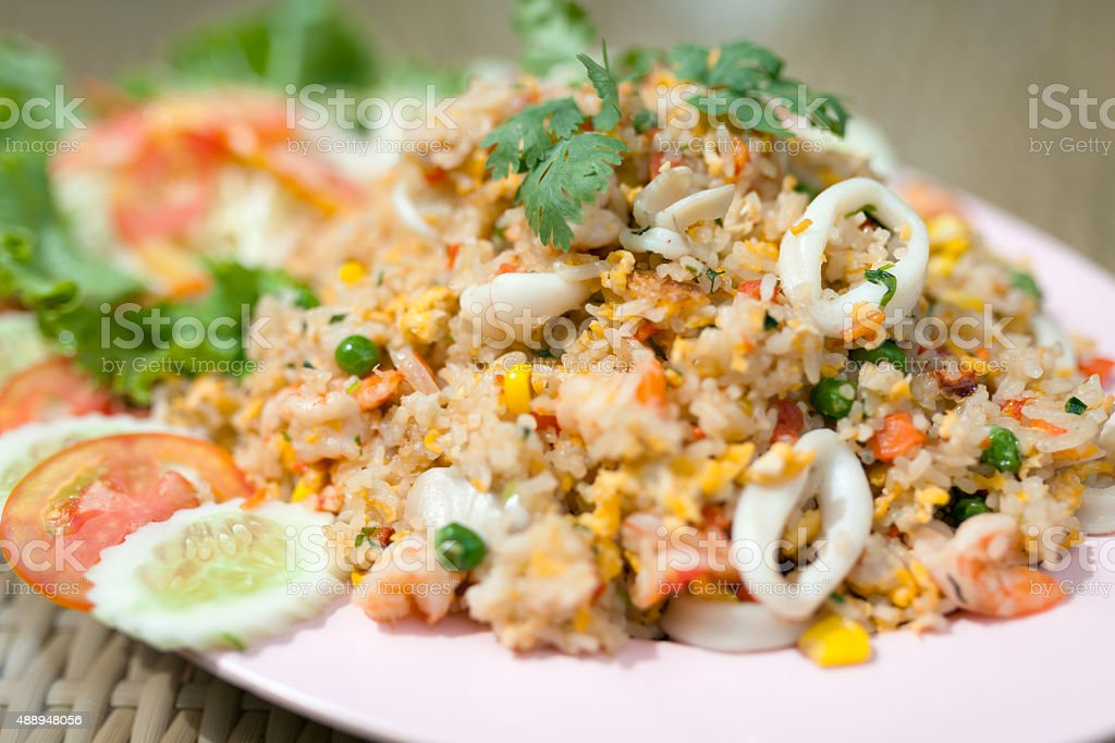 Fried rice with seafood , thai food style. - (Selective focus) stock photo