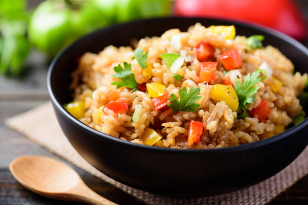 Fried rice with vegetables, Asian food stock photo