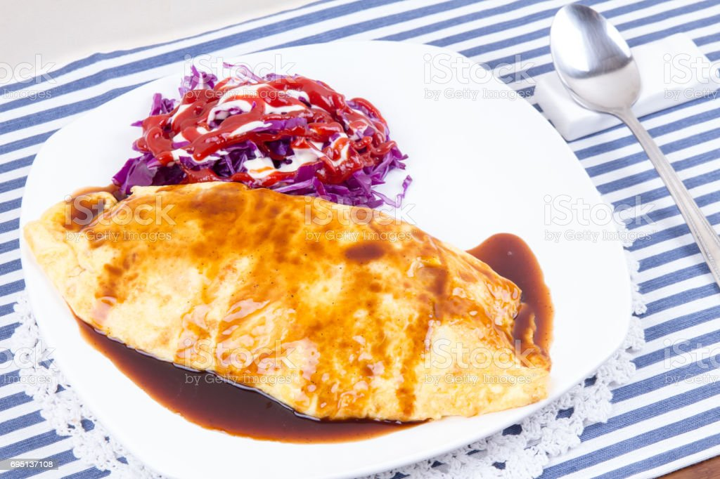 fried rice wrapped in a thin omelette - korea style omelet stock photo