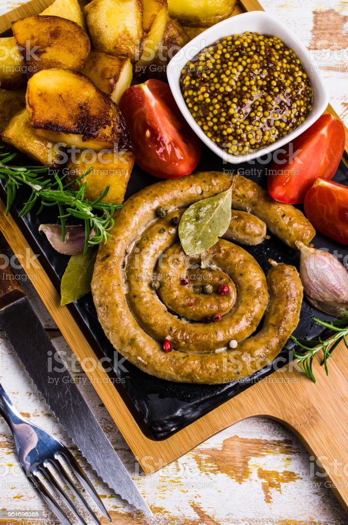 Fried round sausages royalty-free stock photo