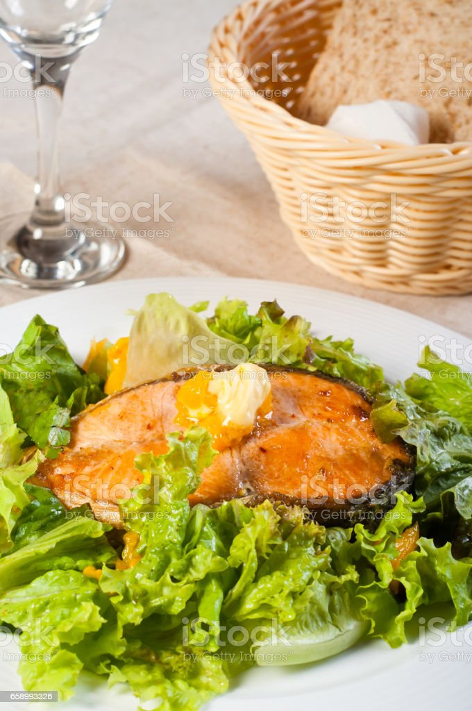 fried salmon on a garden salad royalty-free stock photo