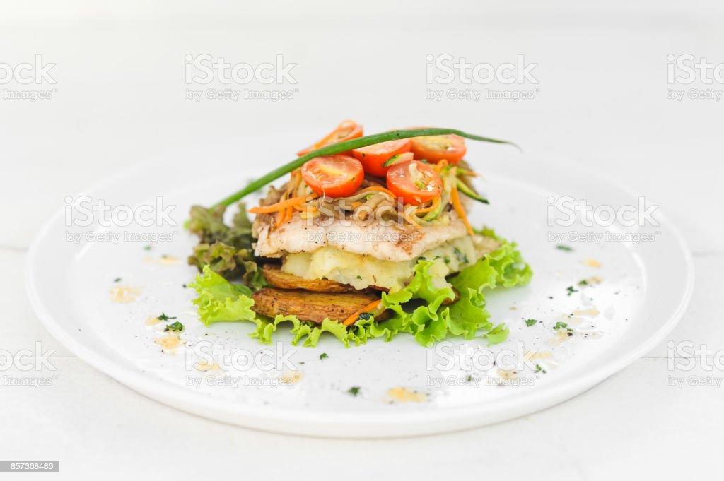 Fried salmon with potatoes stock photo