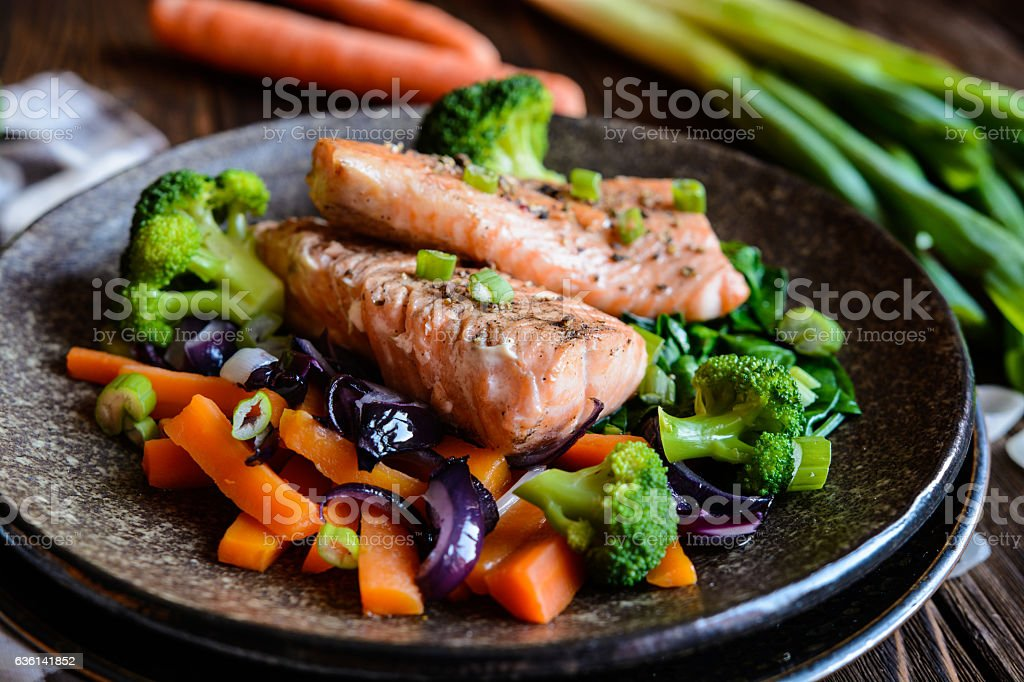 Fried salmon with steamed vegetable stock photo