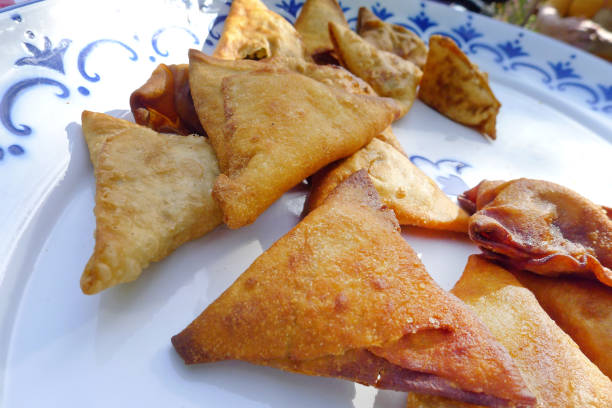 fried samosa from africa - eritrea stock photos and pictures