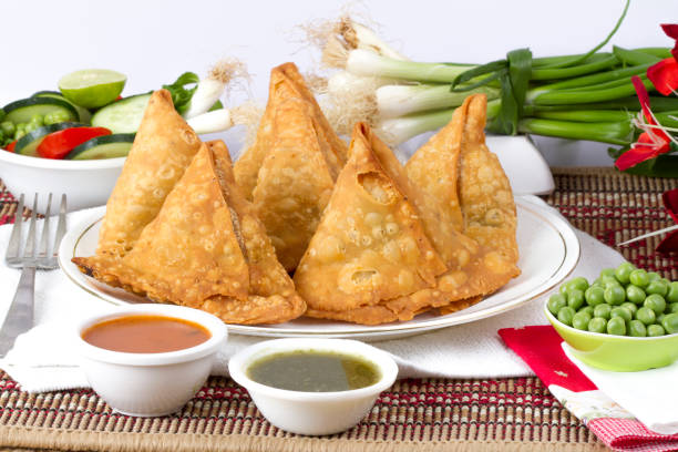 fried samosa - samosa stock photos and pictures