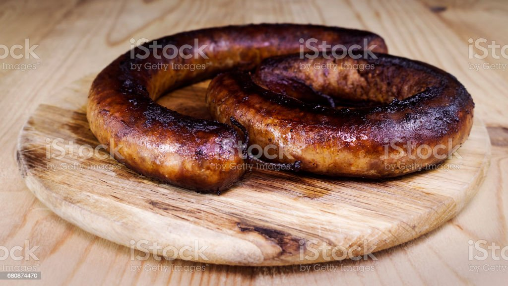 Fried Sausages On a Wooden Board royalty-free stock photo