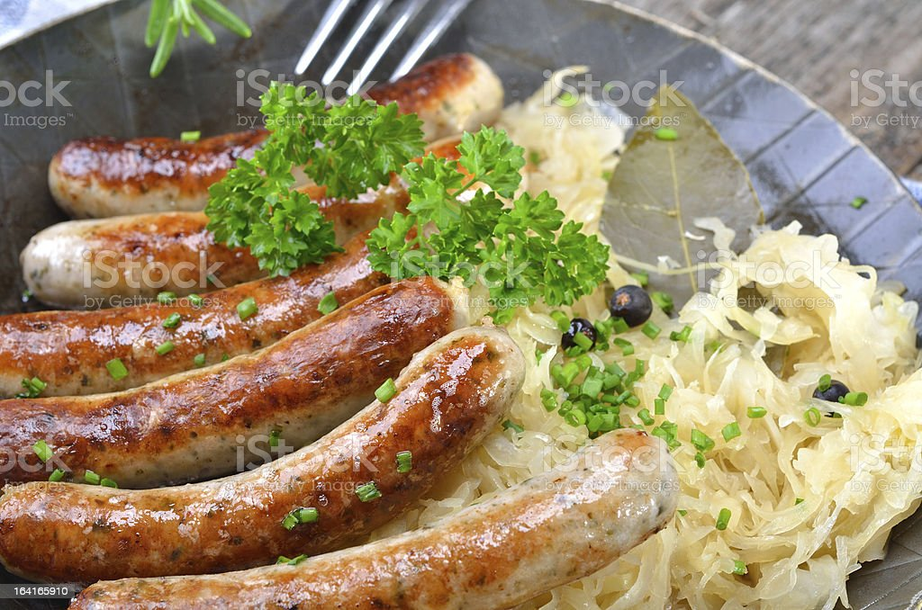 Fried sausages on sauerkraut royalty-free stock photo