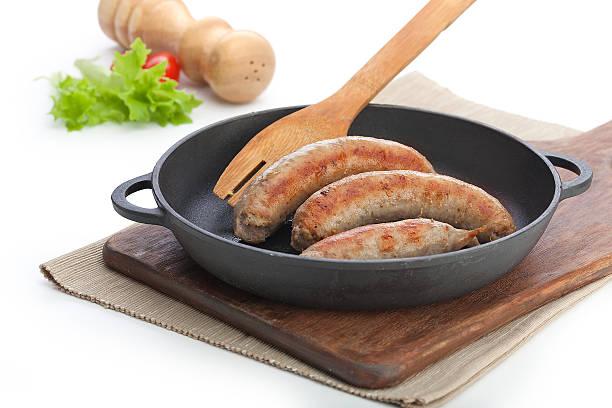 fried sausages - zout smaakstof stockfoto's en -beelden