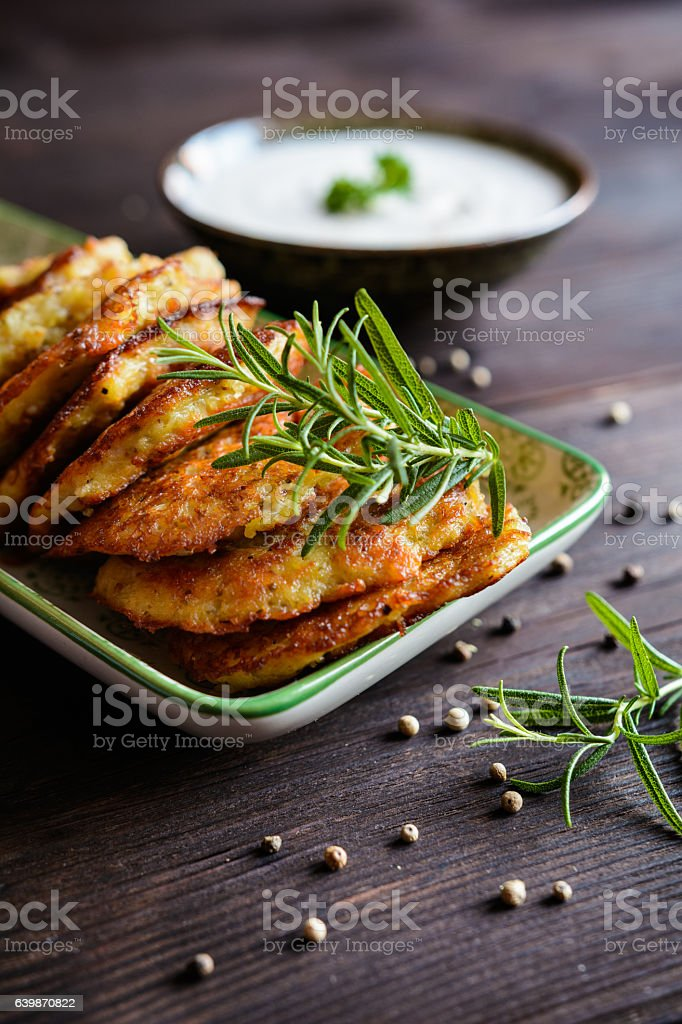 Fried savory pancakes with turkey meat, potato, cheese and herbs stock photo