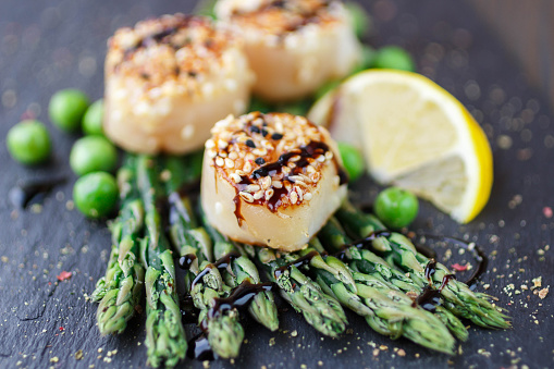 istock Fried scallop  with sesame seeds, balsamic sauce and asparagus 499197728
