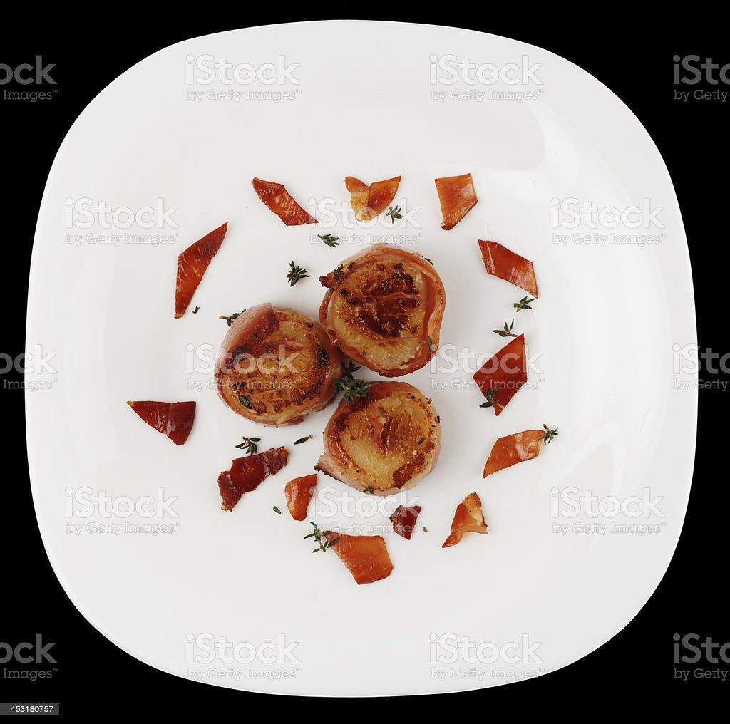 Fried scallops isolated on black background stock photo