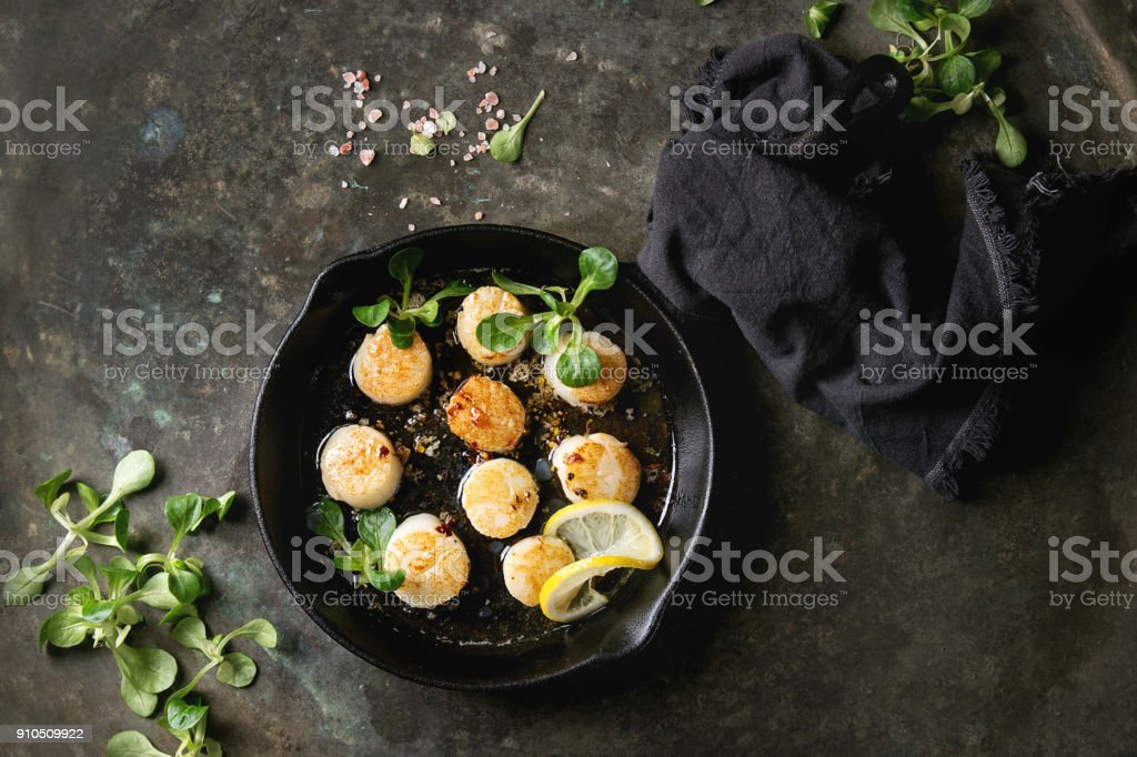 Fried scallops with butter sauce stock photo