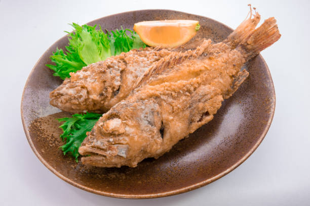 fried scorpion fish - lionfish stock photos and pictures