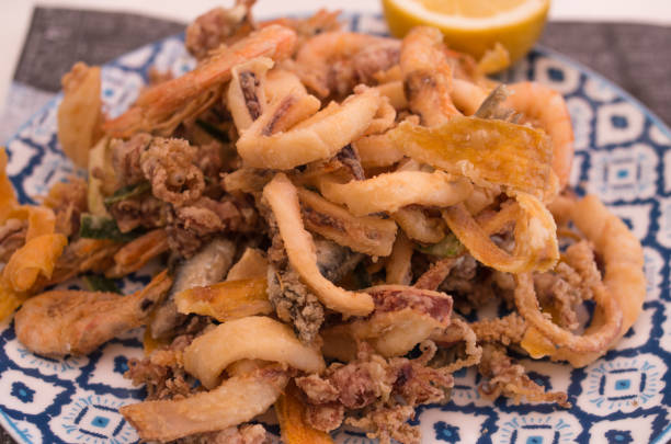 fried sea fish italian - fritto foto e immagini stock