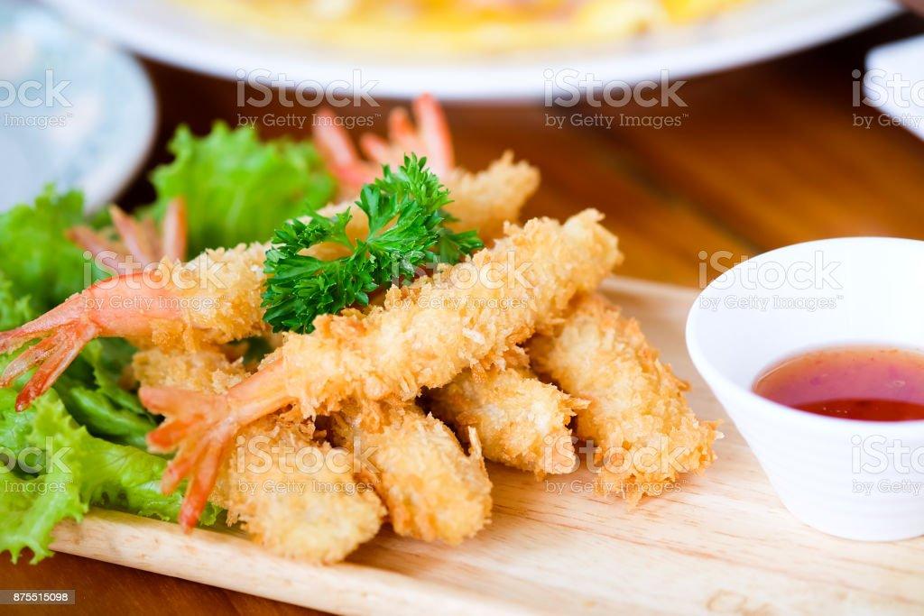 Fried shrimp ball or Tempura Shrimps in wood plate on the table stock photo