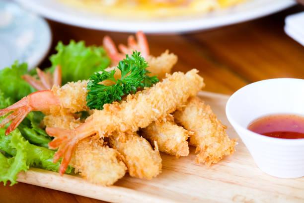 fried shrimp ball or tempura shrimps in wood plate on the table - tempura imagens e fotografias de stock