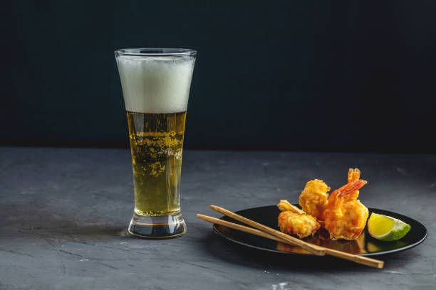 Fried Shrimps tempura and glass of beer stock photo