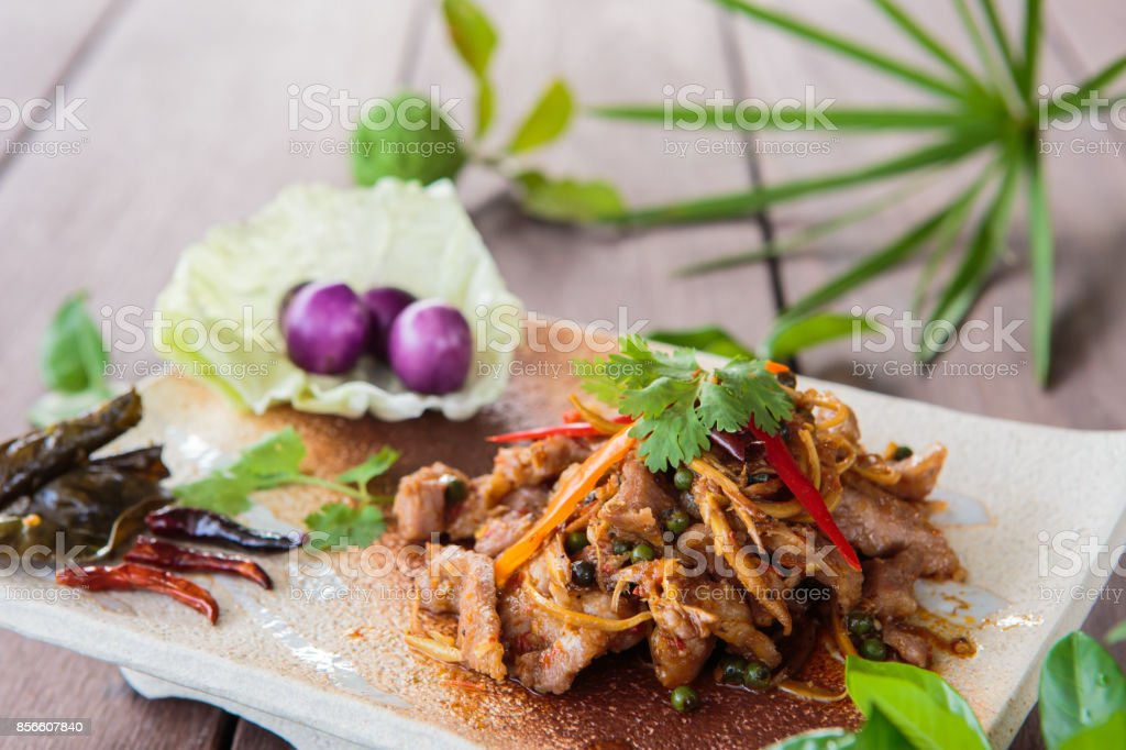 Fried spicy boar food Thailand culinary herbs stock photo