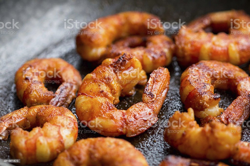 Fried spicy marinated shrimp in pan stock photo