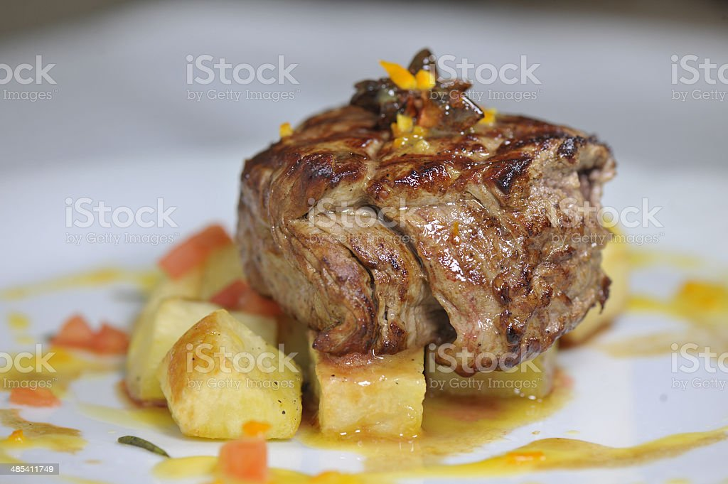 Fried steak with garnish ousom stock photo