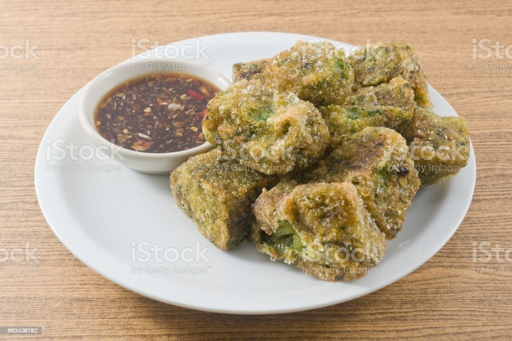 Fried Steamed Garlic Chives Dumpling Served with Spicy Soy Sauce stock photo
