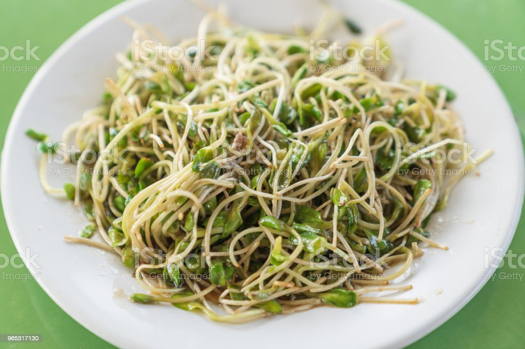 Fried sunflower sprout with oyster sauce on white dish. royalty-free stock photo