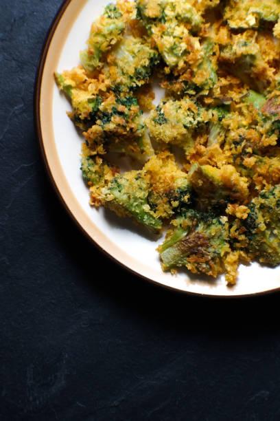 fried tempura broccoli on a ceramic plate. asian cuisine - tempura imagens e fotografias de stock