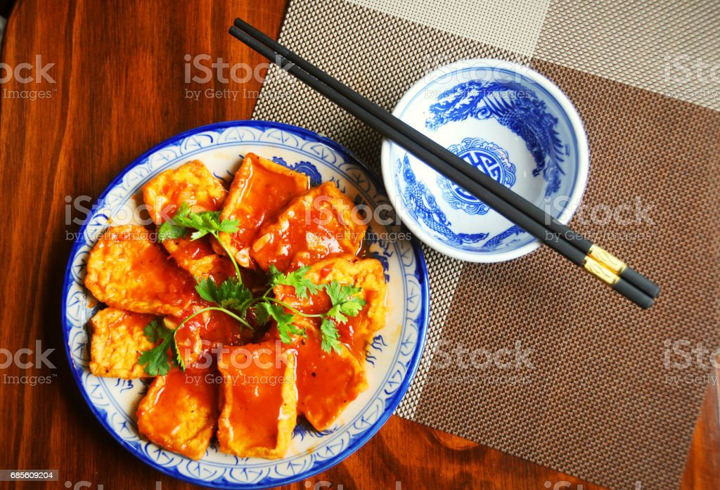 Fried tofu with meat and tomatoes sauce on dish royalty-free 스톡 사진