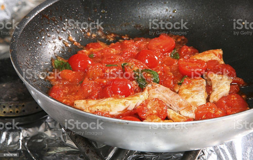 Fried tomato and fish royalty-free stock photo