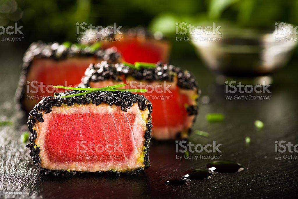 Fried tuna steak in black sesame stock photo