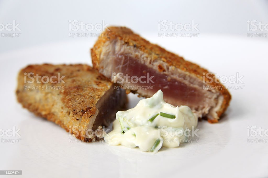 Fried tuna with breadcrumb crust and chive cream royalty-free stock photo