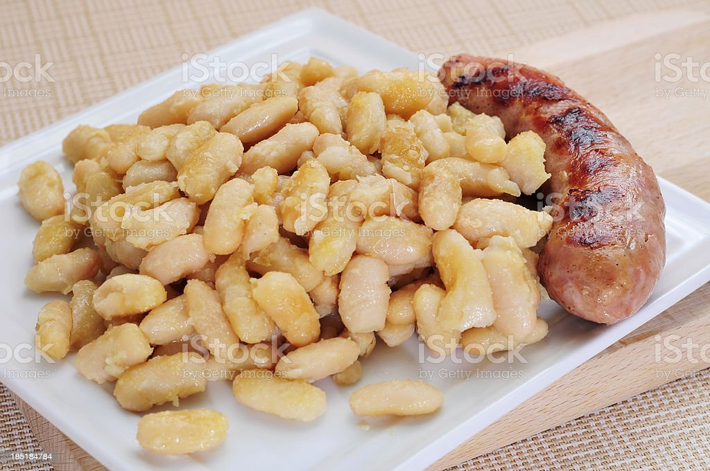 fried white beans and sausage stock photo