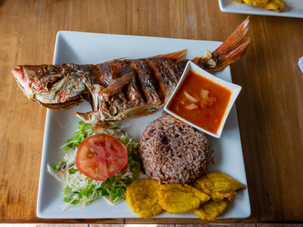 Fried whole fish is a traditional dish in Costa Rica stock photo