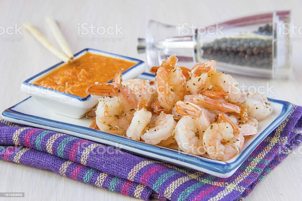 Fried with herbs shrimp and red sauce, delicious appetizer royalty-free stock photo