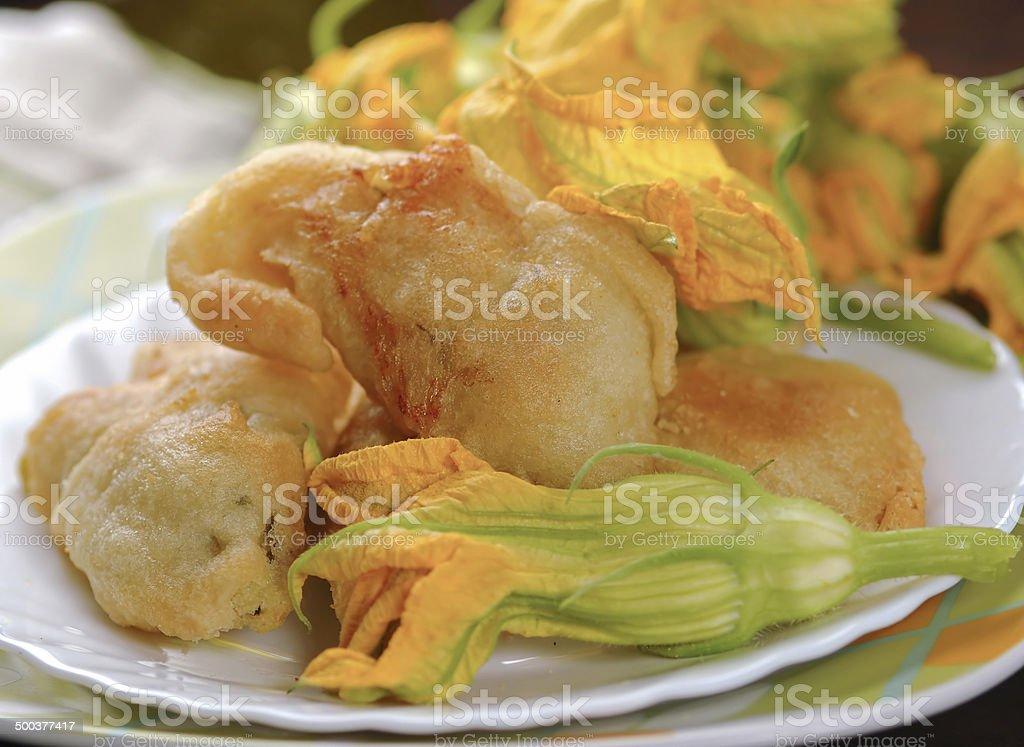Fried zucchini flowers stock photo
