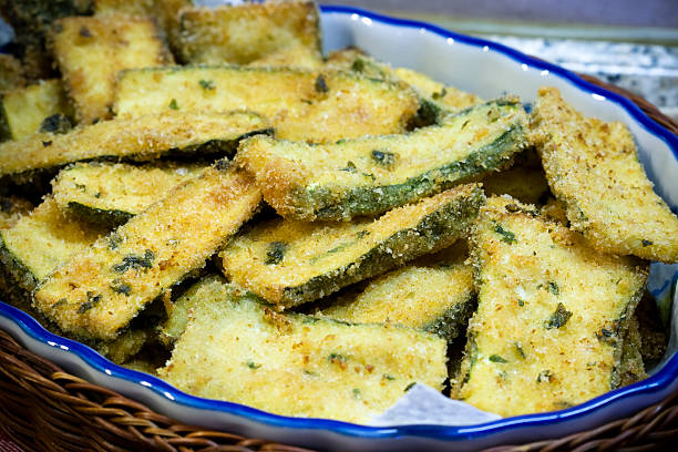 fried zucchini fried zucchini fritter stock pictures, royalty-free photos & images