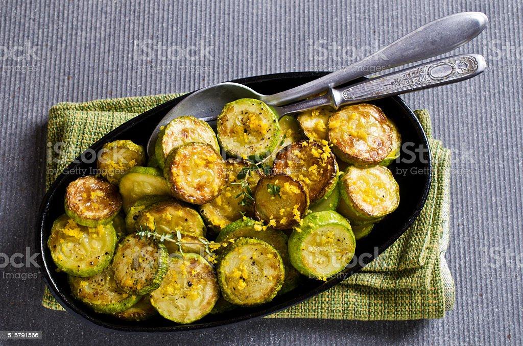 Fried zucchini with lemon zest stock photo