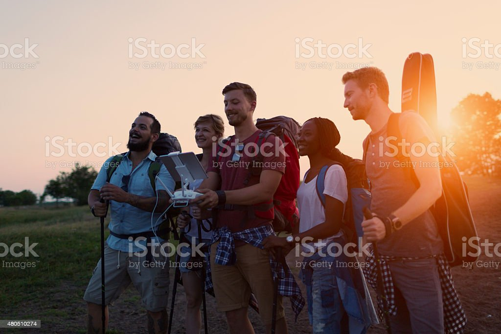 Friend Flying Drone At Hiking. stock photo