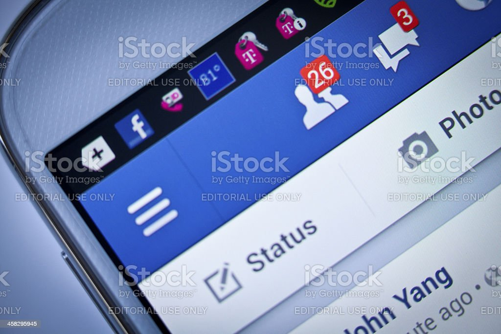 Friend request and message in facebook New York City, USA - August 25, 2013: Close-up view to facebook notifications of friend request and message on a smart phone. Facebook is a social networking service, owned and operated by Facebook, Inc. Advice Stock Photo