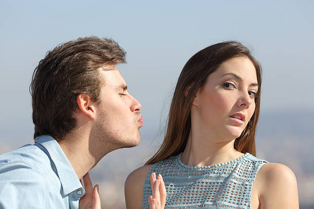 Friend zone concept with woman rejecting man stock photo