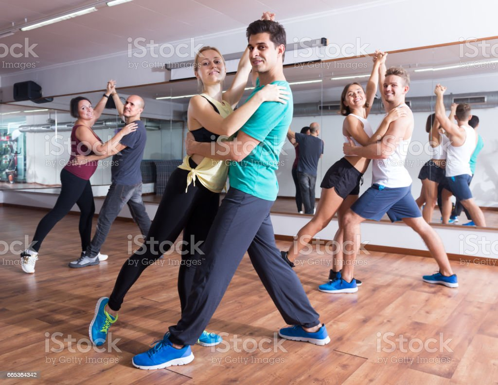 Friendly adults dancing bachata together stock photo