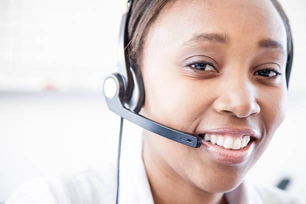 Friendly African Call Center Worker. stock photo