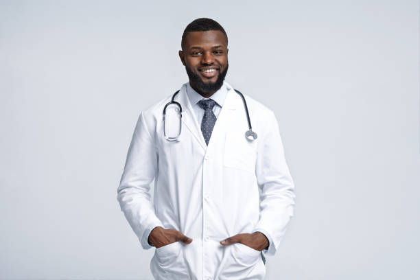 Friendly african male therapist posing over white background stock photo