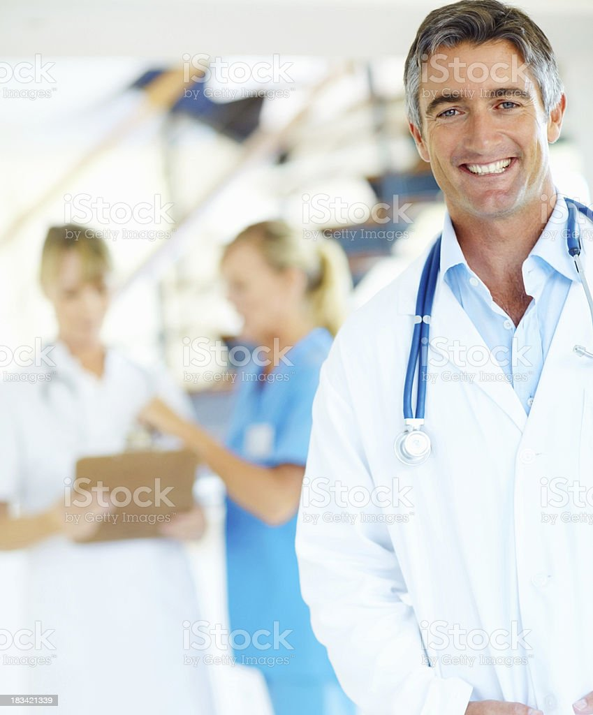 Friendly and confident doctor with stethoscope royalty-free stock photo